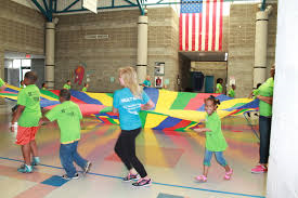 """Children learn the importance of exercise at Hult Heath Center's annual """"Healthy Heroes"""" summer camp. Each year, over 500 at-risk children attend and learn about healthy living and the importance of respecting their bodies."""