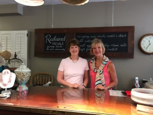 Store manager Debbie Rauh and volunteer Mary Armstrong stand behind the counter of Reclaimed Resale, ready to help customers with purchases and donations.  Photo by Amy Morys.