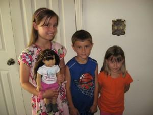Metamora American Girl doll winner  Jillian Bober, 10,   brother Nolan and sister Gianna.