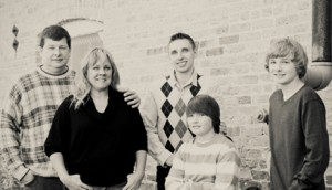 Doug, his wife Kathie and their three sons.