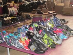 Some of the running shoes ready for shipping after being sorted in the Share Your Soles warehouse. (Kevin Beese/for Chronicle Media)