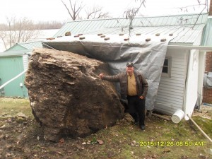 Beyond flooding, record rains last week caused a 60-ton boulder to roll down a hillside and hit a home in Kampsville, according to the Calhoun County Sheriff's office. No one was hurt in the Dec. 26 incident. (Photo from Calhoun County Sheriff's office.)