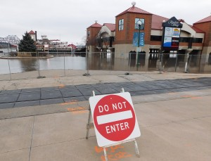 Because of the flooding caused by the Dec. 28 storm, parking is prohibited under the Riverfront Village and in the surface lot between the Riverfront Village and the River Station building. (Chronicle Media photo)