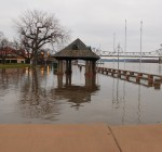 No flood damage along riverfront but sand bags, parking restrictions remain