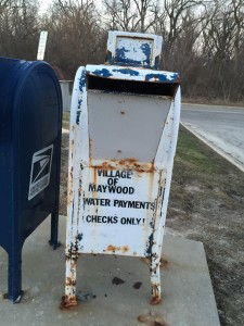 A letter box at the Maywood municipal building collects water payments. (Photo by Jean Lotus/Chronicle Media)