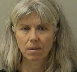 Geneva woman charged in husband's death