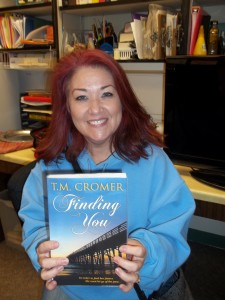 "Tara Cromer displays her first book, ""Finding You,"" which is on the shelf at the Eureka Public Library. Cromer is a Eureka resident and will be promoting her book at a Feb. 27 book signing at the library."