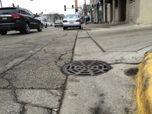Residents say a strong sewer-gas odor sometimes emits from storm sewer grates on Madison Street in Forest Park. (Chronicle Media photo)