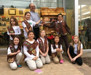 """Yorkville Mayor Gary Golinski joined the Brownie Quest Journey, Troop 1441 in a ribbon cutting and dedication ceremony March 7 for the new Little Library at the Yorkville Parks and Recreation Building , 201 W. Hydraulic St. Inspired by their need for a Take Action Project, Troop 1441 felt that a Little Free Library would benefit the community for many years to come. The Little Free Library is a box full of books where anyone can stop by and pick up or drop off a book or two. The """"little free library"""" movement began with a replica of a one‐room schoolhouse built by Todd Bol in Hudson, Wis., in 2009, as a tribute to his mother, a former teacher. (Photo courtesy City of Yorkville)"""