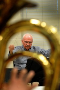 Dick Hart has been director for six years but with the band since its start 30 years ago. He directs the members during an Indian Valley Community Band rehearsal at Sandwich Middle School on Monday, April 4, 2016. Photo by Steven Buyansky