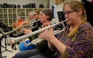 Dawn Trowbridge (right) of Sheridan, Diana Anshakov of Newark and the rest of the trumpet section play during an Indian Valley Community Band rehearsal at Sandwich Middle School on Monday, April 4, 2016. Photo by Steven Buyansky