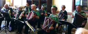 Members of the Peoria Area Accordion Club playing at a local nursing home are (from left) Carol Huff, Dick Tappan, Bonnie Gudat, Tom Doriatti and Judy Ernst. The club plays about 80 shows a year and is open to new members. (Photo courtesy Judy Ernst)