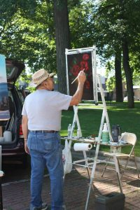 Artists are part of the scene at the annual Metamora Farmers Market held June through September. (Photo courtesy Metamora Farmers Market)