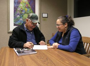 Juan Galvan and Amy Morris, both of St. Charles, meet at the St. Charles Public Library through the Literacy Volunteers Fox Valley.  Morris is a volunteer tutor with the group. (Photo courtesy Literacy Volunteers Fox Valley)