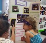 Young scientists at Goodard School display their work