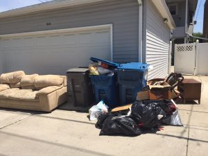 Flood-damaged furniture and other items left in the alley for the trash hauler.
