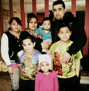 """Jose Juan Moreno, of Bolingbrook, and his family members. Moreno has sought sanctuary in a South Side Chicago church for three months. Immigration officials consider him an """"immigrant fugitive."""" (Cou"""