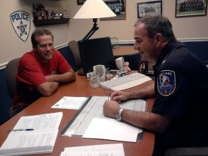 Village of Fox Lake trustee Jeff Jensen and the former Police Chief, Mike Behan, discuss issues confronting the municipality with safety concerns, in a 2014 photo.