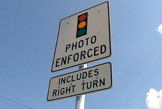 Red-light cameras limit some crashes, cause others — but all ...