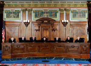 The Illinois Supreme Court. Justices (from left)  Anne M. Burke, Thomas L. Kilbride, Charles E. Freeman, Chief Justice Rita B. Garman, Robert R. Thomas, Lloyd A. Karmeier and Mary Jane Theis.