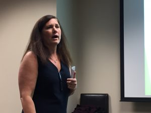 Northern Illinois University business school professor Christine Mooney speaks about social enterprise businesses and impact investing in Chicago Sept. 20. (Chronicle Media)
