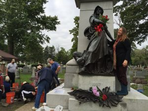 1)Supporter Jill Wagner delivers roses to the Haymarket statue during the archaeological dig Oct. 2. (Chronicle Media Photo)