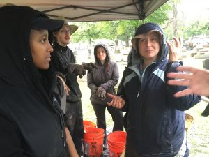 1)Rebecca Graff (right), urban archaeologist at Lake Forest College, speaks to students at the Haymarket Martyrs Monument dig Oct. 1 (Chronicle Media Photo)