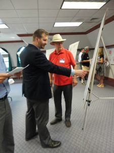 City of Pekin Mayor John McCabe (right) consults with Tri County Regional Planning Commission senior planner Nick Hayward on potential bike trail projects Oct. 5 at the TCRPC's BikeConnect HOI open house. (Photo by Holly Eitenmiller / for Chronicle Media)