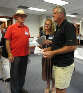 Village of Metamora Mayor Ken Maurer (right) and his wife Sue discuss potential improvements to regional bike trails with City of Pekin Mayor John McCabe at the Tri County Regional Planning Commission's BikeConnect HOI open house Oct. 5. (Photo by Holly Eitenmiller / for Chronicle Media)