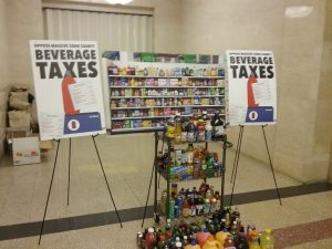 A display by opponents of the Cook County sugary beverage tax show all the drinks that will be included in the tax, which passed last week by the narrowest of margins. (Photo by Kevin Beese/for Chronicle Media)