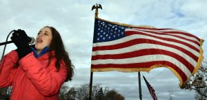 Tricia Pabst of Lincolnwood performs the National Anthem at the Lincolnwood Turkey Trot. (Photo by Karie Angell Luc/for Chronicle Media)