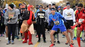 Melissa Rimdzius (left) of theVillage of Lincolnwood, in a turkey costume, is agood sport at the start line.(Photo by Karie Angell Luc/for Chronicle Media)