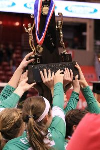 Eureka players hoist the championship trophy. (Photo by Kalli McDonald/for Chronicle Media)