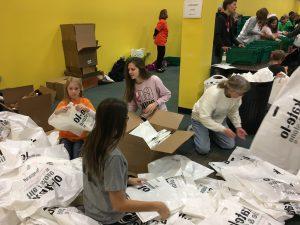 Volunteers sort bags.