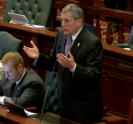 Veto override, tax increase break Illinois budget logjam