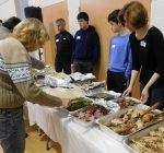 Lazarus House volunteers put the giving in free holiday feast