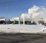 Large fire tears through Washington car dealership
