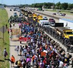 Pfleger leads thousands on march for peace down Dan Ryan