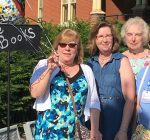 Woman gives the presents — five dozen books — to mark her 60th birthday
