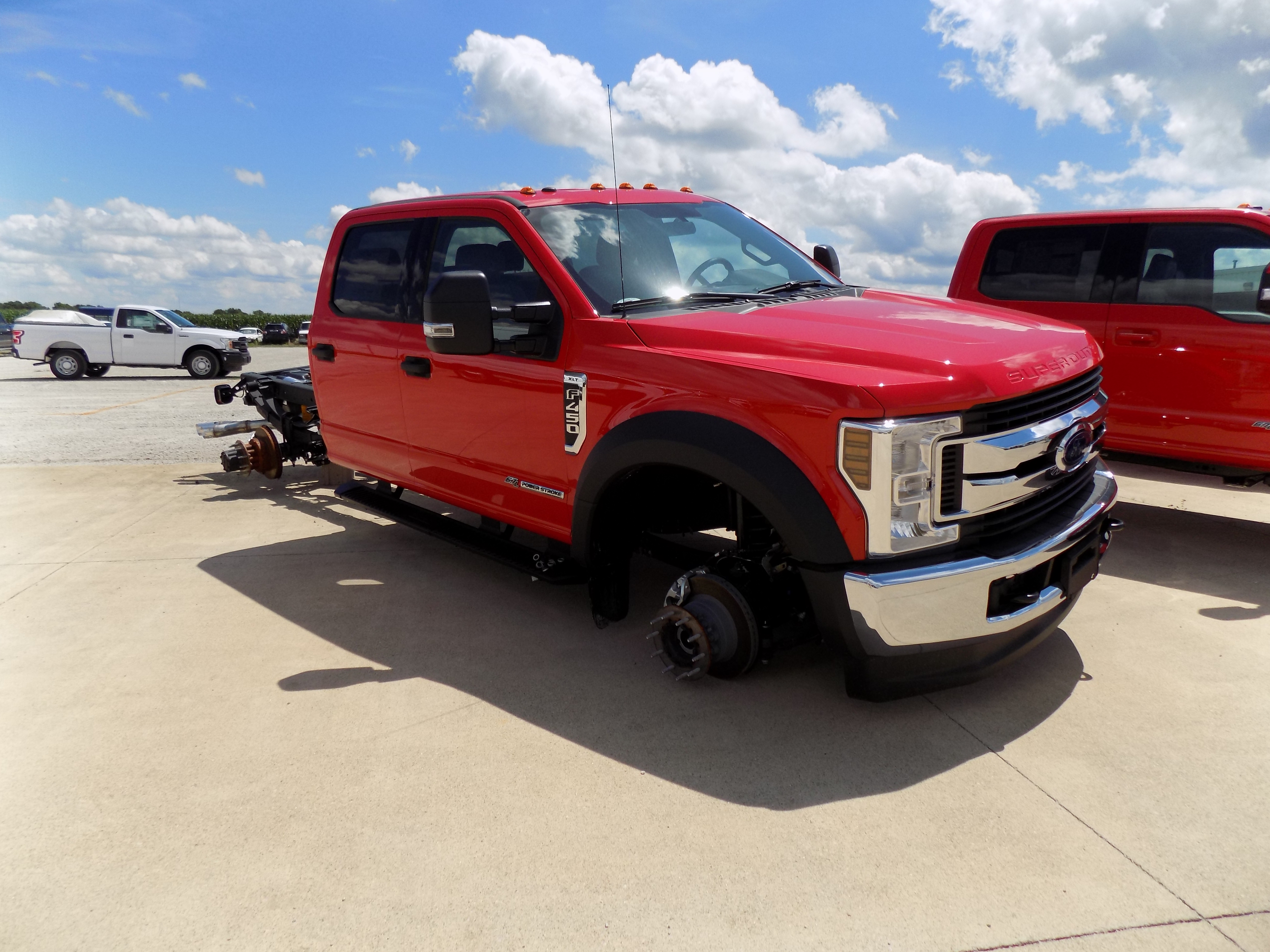 During The Early Morning Hours Of July 26 Thieves Stripped Two New Ford Super Duty F 450 Xlt Trucks 12 Wheels Which Were Loaded And Hauled Away In A