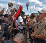 Police arrest protestors during Labor Day march along Kennedy Expressway