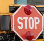 House OKs doubling fines for drivers who pass stopped school buses