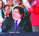 Pritzker tops 100 bills signed with distracted driving, food stamp measures