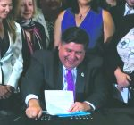 Pritzker signs bills protecting immigrant youths