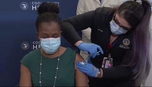 Illinois health director receives COVID-19 vaccination